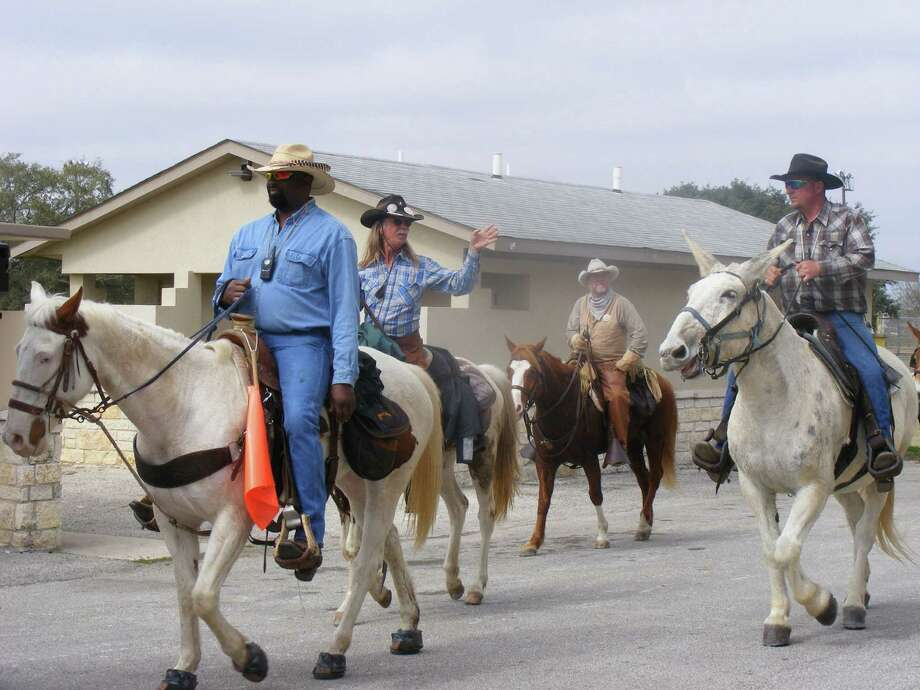 A pack of trail riders is ready to dismount and enjoy a hot lunch at Pickrell Park in Schertz Feb. 7 as part of the annual trail ride to the San Antonio Stock Show and Rodeo. Photo: David DeKunder / NE Herald