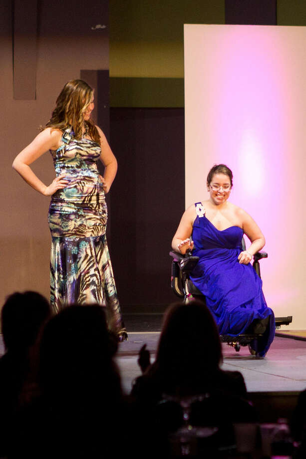 "Sarah Granados (right) and her buddy for the night, Grace Atkins, participate in 2012's inaugural ""Hand In Hand Fashion Show."" Tickets are on sale for Saturday's second annual event at Morgan's Wonderland. Photo: Photo Courtesy Of Monarch Academy"