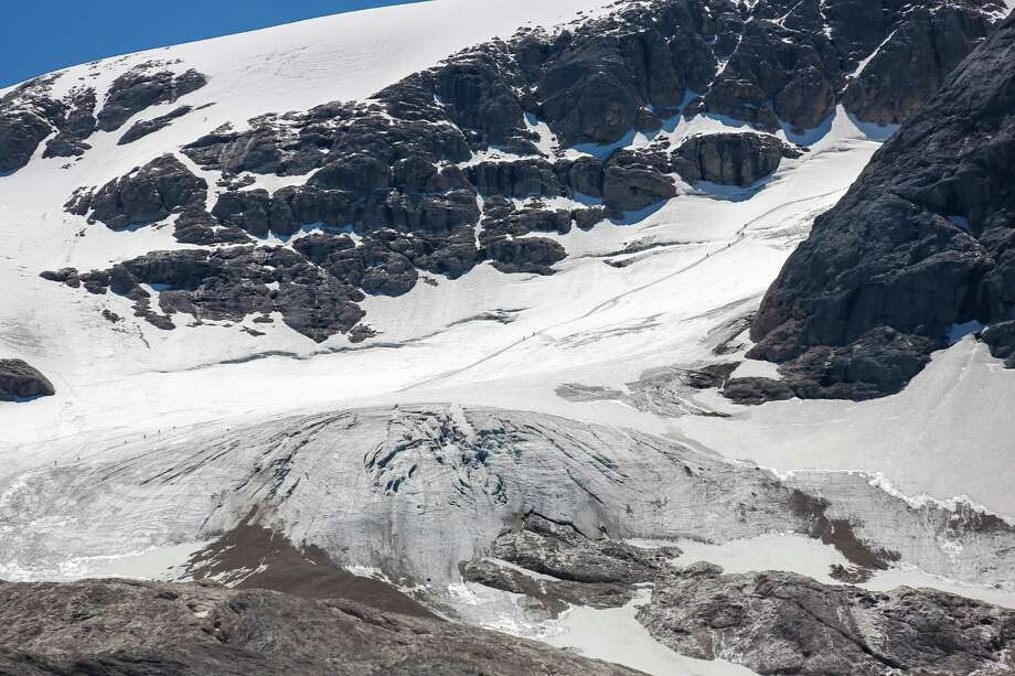 The glacier Marmolada at Passo Fedaia with the lake Lago Fedaia in Val di Fassa in the Dolomite Alps on July 18, 2012 in Marmolada, Italy. The lake is at 2057 m altitude.Landscape and panoramic view. (Photo by EyesWideOpen/Getty Images) Photo: EyesWideOpen, Multiple / 2012 EyesWideOpen