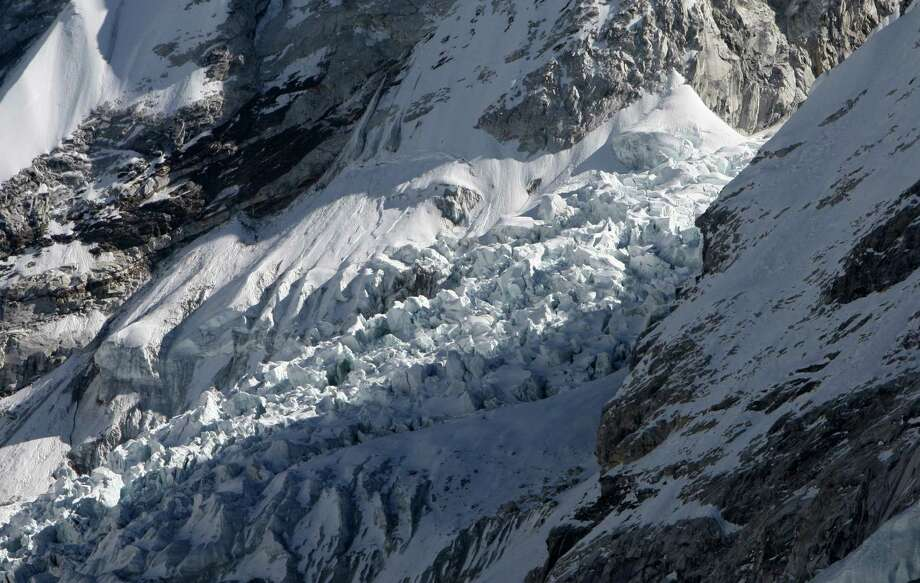 This photograph taken on December 4, 2009 shows the Khumbu Glacier, one of the longest glaciers in the world, in the Everest-Khumbu region some 140 km (87 miles) northeast of Kathmandu. The Himalayan glaciers provide water for more than a billion people in Asia, but experts say they are melting at an alarming rate, threatening to bring drought to large swathes of the continent within decades. (PRAKASH MATHEMA/AFP/Getty Images) Photo: PRAKASH MATHEMA, Multiple / 2009 AFP