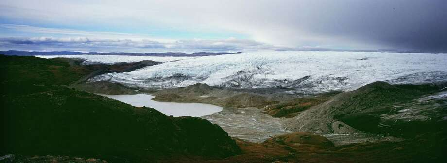 A melt water lake seen under a glacier. September 03, 2007 , East of Kangerlussuaq , Greenland. Scientists believe that Greenland, with its melting ice caps and disappearing glaciers, is an accurate thermometer of global warming. (Photo by Uriel Sinai/Getty Images) Photo: Uriel Sinai, Multiple / 2007 Getty Images