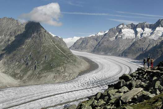 The Aletsch glacier, the largest in the Alps, continues towards  the river Rhone 18 August 2007 near the mountain resort of Bettmeralp. Data shows that the melting of mountain glaciers worldwide is accelerating, a clear sign that climate change. (FABRICE COFFRINI/AFP/Getty Images) Photo: FABRICE COFFRINI, Multiple / 2007 AFP