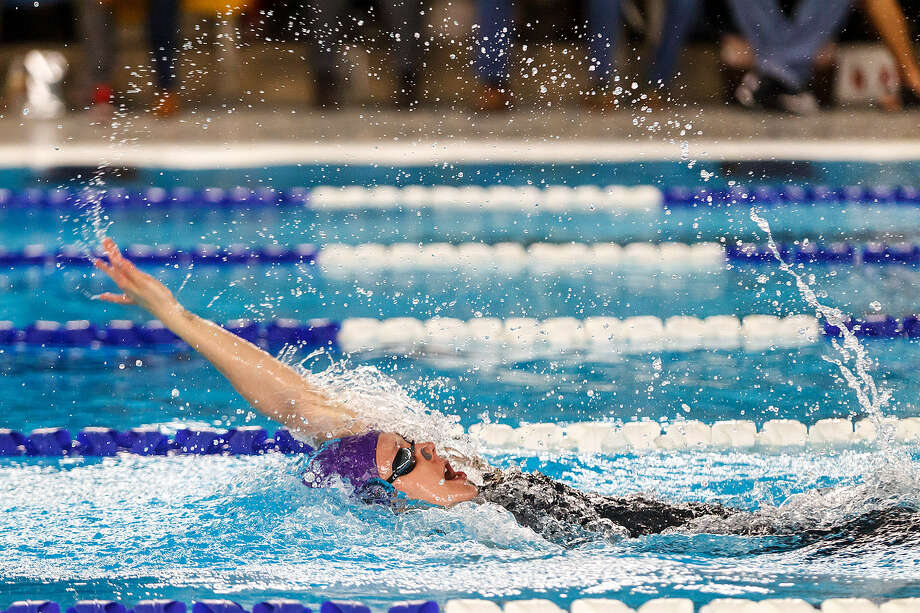 Boerne High School's Julia Cook set a new meet record in the girls' 100-yard backstroke with a time of 58.56 during the UIL Region VIII-4A Swimming and Diving Championships on Saturday at Block Auditorium. Photo: Marvin Pfeiffer/ Northwest Weekly