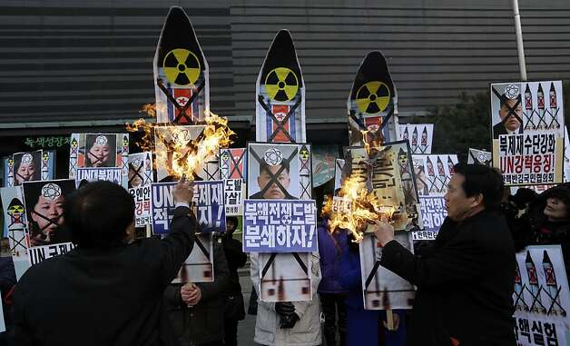 "South Korean protesters burn the pictures of North Korean leader Kim Jong Un during an anti-North Korea rally following a nuclear test conducted by North Korea, in Seoul, South Korea, Tuesday, Feb. 12, 2013. North Korea apparently conducted a widely anticipated nuclear test Tuesday, strongly indicated by an ""explosion-like"" earthquake that monitoring agencies around the globe said appeared to be unnatural. The letters read "" Support, U.N. sanction strongly and Out, Kim Jong Un."" (AP Photo/Lee Jin-man) Photo: Lee Jin-man, Associated Press"