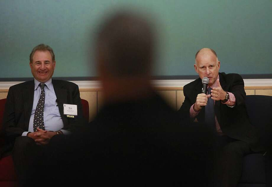 Gov. Jerry Brown takes questions during an Oakland panel on housing moderated by Ken Rosen (left).