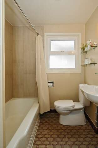 Bathroom of 334 N.W. 76th St. The 1,800-square-foot house, built in 1947, has two bedrooms on the main floor, a family room with a fireplace in the basement, one bathroom, a porch, a deck and a patio on a 4,120-square-foot lot. It's listed for $450,000. Photo: Courtesy Merritt Hess/Windermere Real Estate