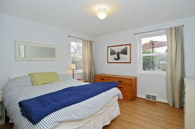 Bedroom of 334 N.W. 76th St. The 1,800-square-foot house, built in 1947, has two bedrooms on the main floor, a family room with a fireplace in the basement, one bathroom, a porch, a deck and a patio on a 4,120-square-foot lot. It's listed for $450,000. Photo: Courtesy Merritt Hess/Windermere Real Estate