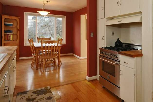 Kitchen of 334 N.W. 76th St. The 1,800-square-foot house, built in 1947, has two bedrooms on the main floor, a family room with a fireplace in the basement, one bathroom, a porch, a deck and a patio on a 4,120-square-foot lot. It's listed for $450,000. Photo: Courtesy Merritt Hess/Windermere Real Estate