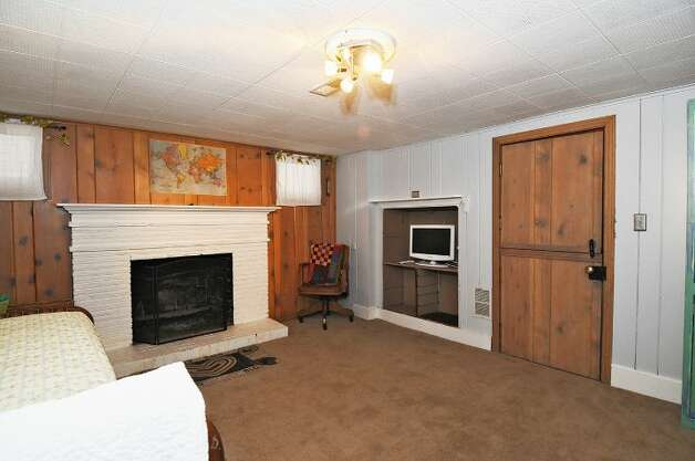 Family room of 334 N.W. 76th St. The 1,800-square-foot house, built in 1947, has two bedrooms on the main floor, one bathroom, a porch, a deck and a patio on a 4,120-square-foot lot. It's listed for $450,000. Photo: Courtesy Merritt Hess/Windermere Real Estate