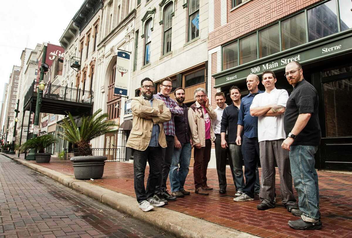 Joshua Martinez, from left, Ryan Rouse, Justin Burrows, Brad Moore, Hank Fasthoff, Brian Fasthoff, Steve Hannigan, David Coffman and Matt Wommack plan to open bars and restaurants on or near the 300 block of Main in downtown.