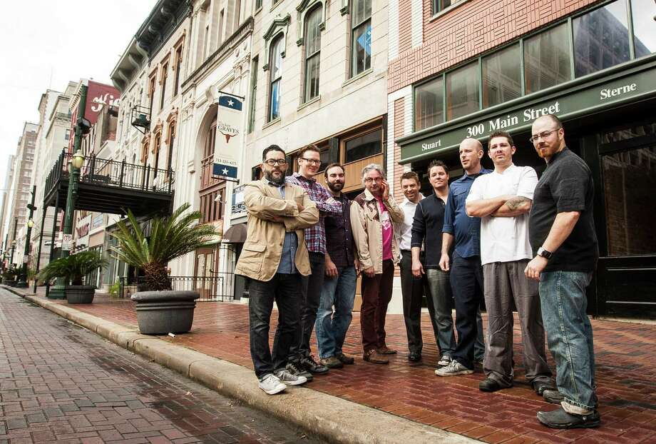 Joshua Martinez, from left, Ryan Rouse, Justin Burrows, Brad Moore, Hank Fasthoff, Brian Fasthoff, Steve Hannigan, David Coffman and Matt Wommack plan to open bars and restaurants on or near the 300 block of Main in downtown. Photo: Nick De La Torre, Staff / © 2010 Houston Chronicle
