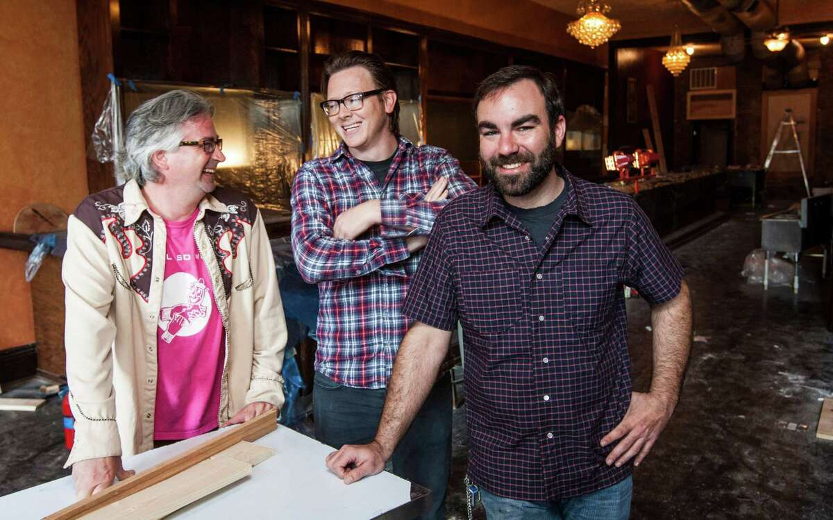Brad Moore, left, Ryan Rouse, center, and Justin Burrows, stand in what will be their bar called Bad News Bar, Tuesday, Feb. 5, 2013, in downtown Houston. ( Nick de la Torre / Chronicle )