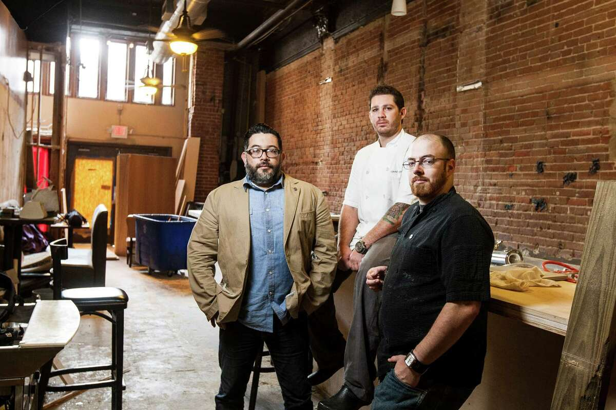 Joshua Martinez, from left, David Coffman and Matt Wommack are planning a menu that will focus on traditional ramen recipes and other surprises for Goro & Gun, which will open in a building at 306 Main that was built in 1908.