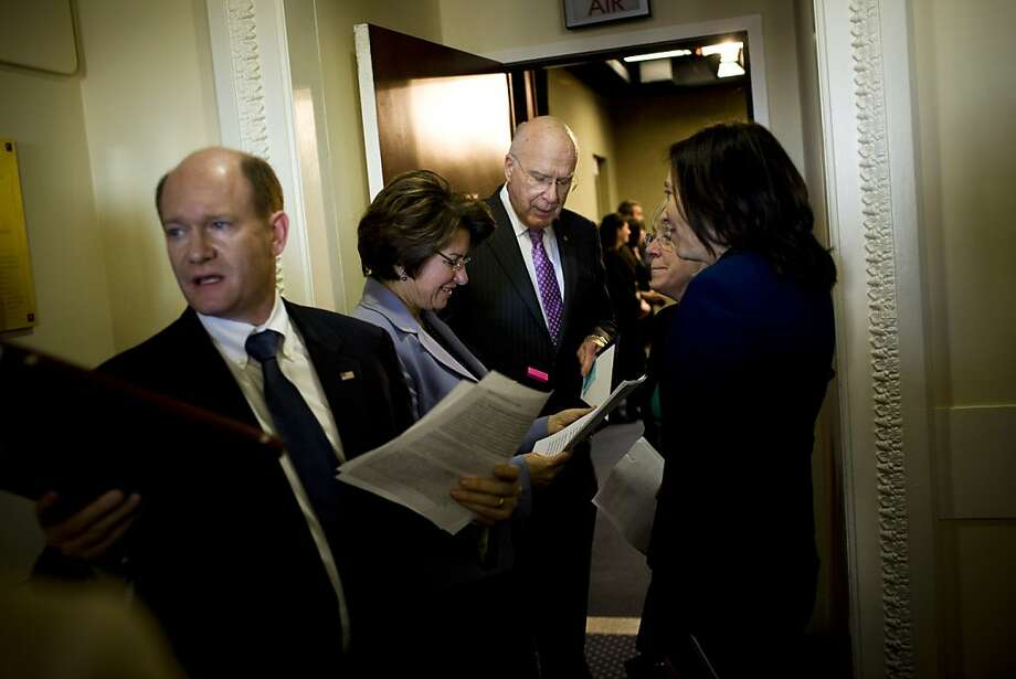Democratic Sens. Chris Coons of Delaware (left), Amy Klobuchar of Minnesota, Patrick Leahy of Vermont and Maria Cantwell of Washington prepare for a news conference. Photo: Christopher Gregory, New York Times