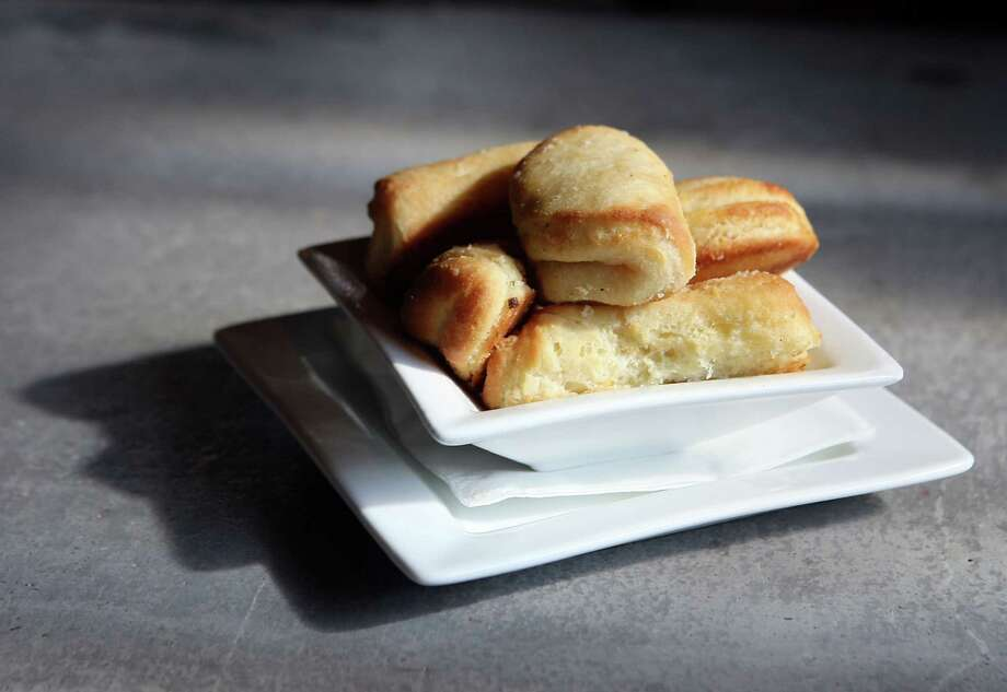 Yeast or other rolls taste better when they're heated. Even if you buy them off the shelf at the supermarket, take time to warm rolls thoroughly and serve them with room-temperature butter. Sprinkle a little fleur de sel (French salt) or other finishing salt atop the butter to make it even better. Photo: James Nielsen, Staff / © Houston Chronicle 2013