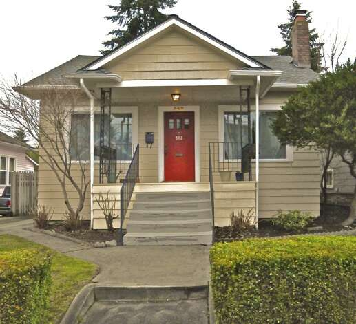 Listed for just $50 less is 542 N. 80th St. The 1,890-square-foot house, built in 1922, has four bedrooms, two bathrooms, a front porch and a fenced yard on a 4,080-square-foot lot. Photo: Courtesy Andrea Hamley And Danielle Williams/Lake & Co. Real Estate