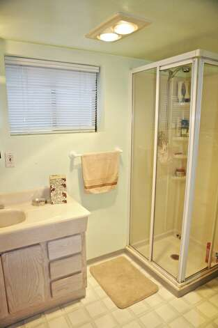Bathroom of 542 N. 80th St. The 1,890-square-foot house, built in 1922, has four bedrooms, two bathrooms, a front porch and a fenced yard on a 4,080-square-foot lot. It's listed for $449,950. Photo: Courtesy Andrea Hamley And Danielle Williams/Lake & Co. Real Estate