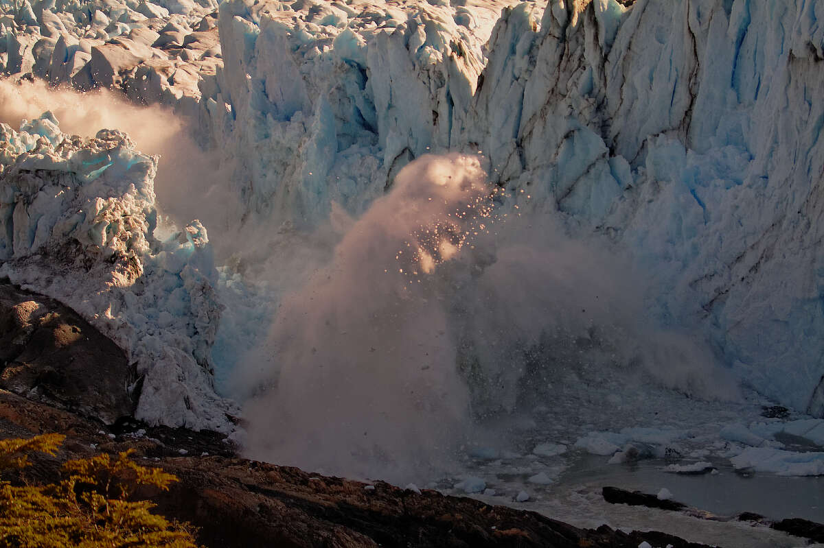 The ice bridge on the Perito Moreno Glacier in mid collapse was captured in a series of photos by Christian Grosso. You can see the entire series on his Demontix webpage.