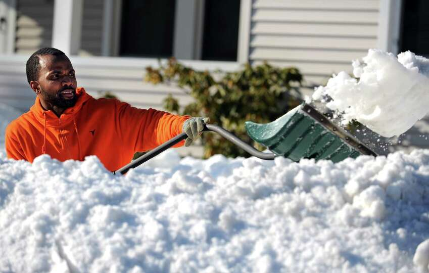 Kenny Pettway works to shovel out his driveway in Bridgeport, Conn. Tuesday, Feb. 12, 2013 following