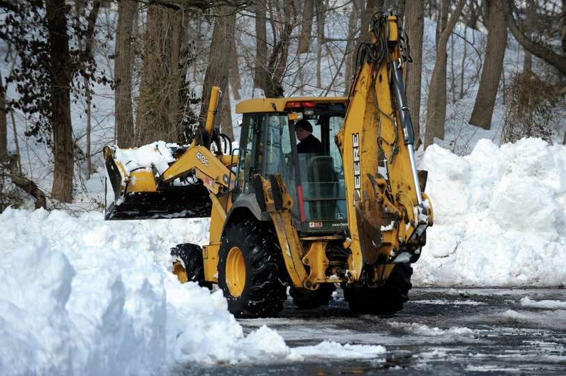 Connecticut continues snow cleanup Tuesday, Feb. 12, 2013 following a weekend storm that dumped up t