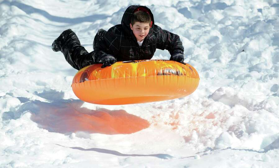 Michael Marino, 12, of Ansonia, sleds Tuesday, Feb. 12, 2013 in Ansonia, Conn.