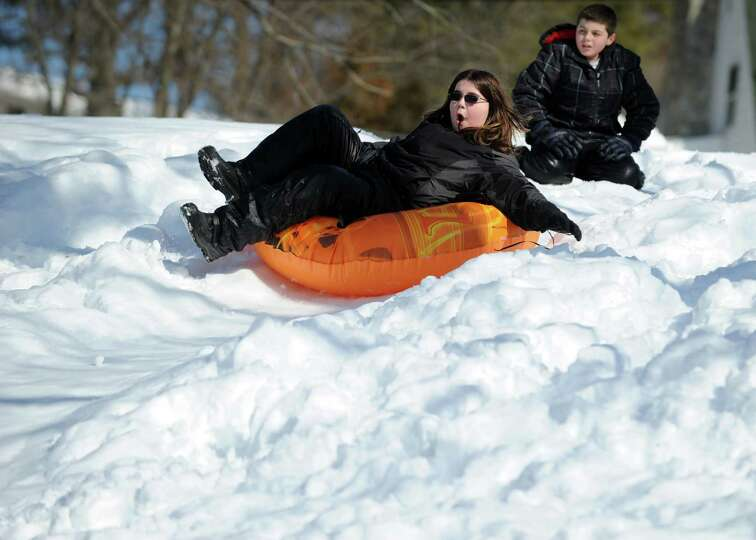 Johnny Nimons, 12, of Ansonia, sleds Tuesday, Feb. 12, 2013 in Ansonia, Conn.