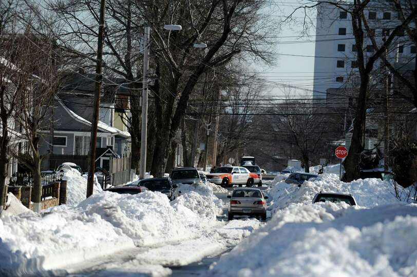 Roads in Bridgeport, Conn. remain congested with snow Tuesday, Feb. 12, 2013 following a weekend sto