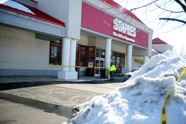 The Staples store in Shelton, Conn was evacuated Tuesday, Feb. 12, 2013 because of a potential roof collapse following a weekend storm that dumped up to 3 feet of snow across the state. Photo: Autumn Driscoll