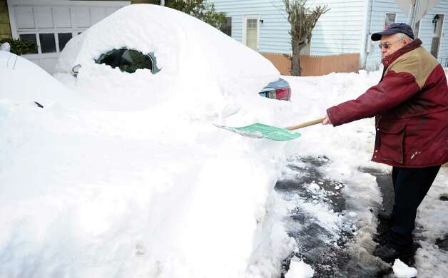 Richard Ostaszeski shovels his driveway Tuesday, Feb. 12, 2013 in Seymour, Conn.  Ostaszeski recently broke his hip and was advised not to do any heavy lifting but needed to get to his car. Photo: Autumn Driscoll