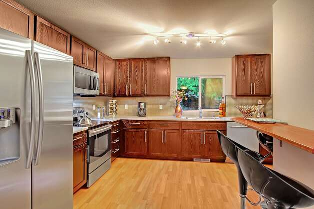 Kitchen of 9225 7th Ave. N.W. The 1,990-square-foot house, built in 1920, but extensively remodeled, has four bedrooms, 2.25 bathrooms, a family room, a den, a porch and a deck on a 6,969-square-foot lot. It's listed for $479,000. Photo: Vista Esate Imaging/Courtesy Francine Walsh/Real Property Associates