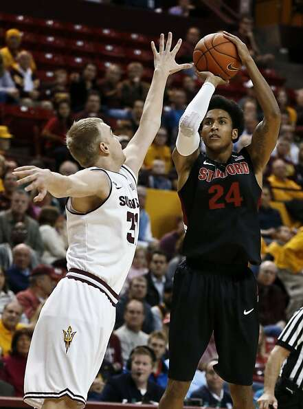 Stanford's Josh Huestis (24) hits a jump shot over Arizona State's Jonathan Gilling during the first