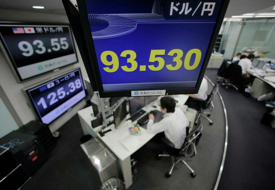 Currency traders work on the foreign exchange market in Tokyo this month. Much of the recent volatility in foreign exchange markets has been a byproduct of developments affecting the Japanese yen. Photo: Itsuo Inouye, STF / AP