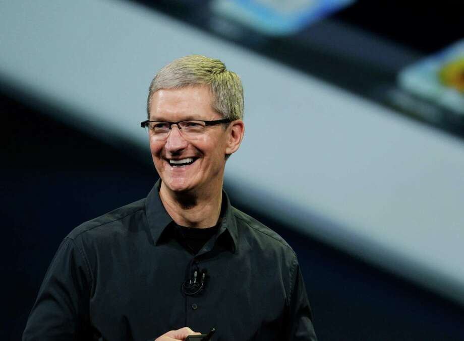 Tim Cook, shown in March, says Apple is looking at ways to give more cash to shareholders. Photo: Paul Sakuma, STF / AP