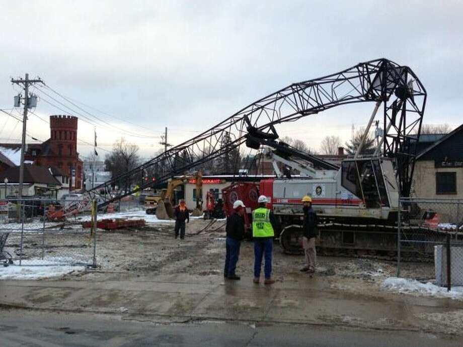 A crane collapsed at the construction site on the corner of Lake and Pavilion Place Tuesday afternoon in Saratoga Springs, N.Y. (Skip Dickstein/Times Union)