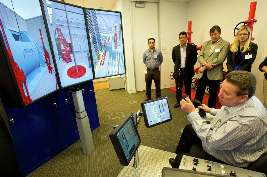 "BP employee Jim Borthwick talks about safety and simulator training at the well monitoring facility at BP's West Houston campus. ""We want to be the Harvard of well control,"" said Mark Venettozzi, a BP global training manager. Photo: Brett Coomer, Houston Chronicle / © 2013 Houston Chronicle"