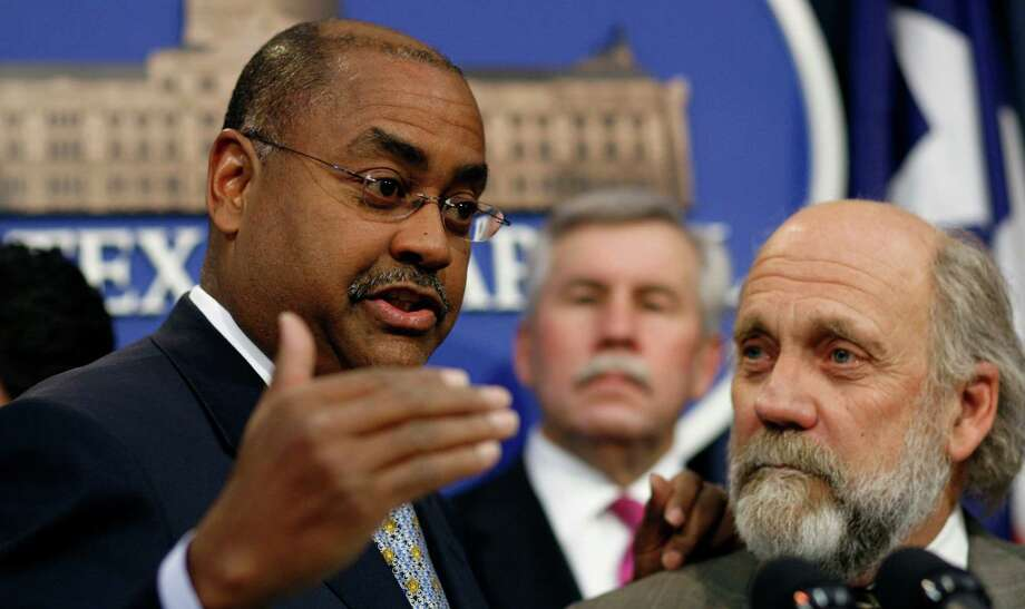 "Sen. Rodney Ellis, D-Houston, left, speaks during a news conference Monday, Feb. 2, 2009, in Austin, Texas. Sen. Troy Fraser, R-Horseshoe Bay, is in the center.  Tom ""Smitty"" Smith, with Public Citizen, is on the right.  Clean power proponents and lawmakers released a study on solar power's job creation and energy savings potential in Texas and to highlight bipartisan support for increasing solar power generation in Texas. (AP Photo/Harry Cabluck) Photo: Harry Cabluck, STF / AP"