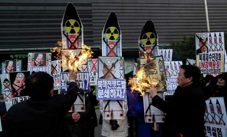 South Korean protesters on Tuesday burn pictures of North Korea's leader in response to nuclear tests. Photo: Lee Jin-man, STF / AP