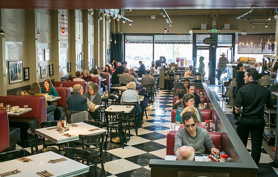Saul's in Berkeley has a classic deli tone, with its red booths and nostalgic wall photos. And lots of corned beef and pastrami. Photo: John Storey, Special To The Chronicle