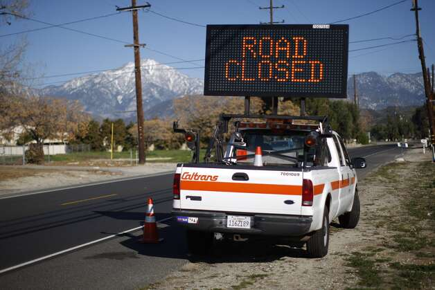 A sign announces the closure of  Highway 38 to Big Bear Lake,  Calif., as a standoff with the man  believed to be fugitive triple murder suspect Christopher Dorner continues.