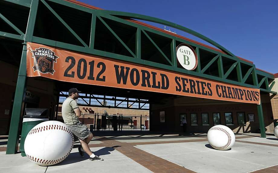 Chris Hughes waits for autographs from San Francisco Giants players after they arrived for spring training baseball, Tuesday, Feb. 12, 2013, in Scottsdale, Ariz. The pitchers and catchers for the defending World Champions start workouts on Wednesday. (AP Photo/Darron Cummings) Photo: Darron Cummings, Associated Press