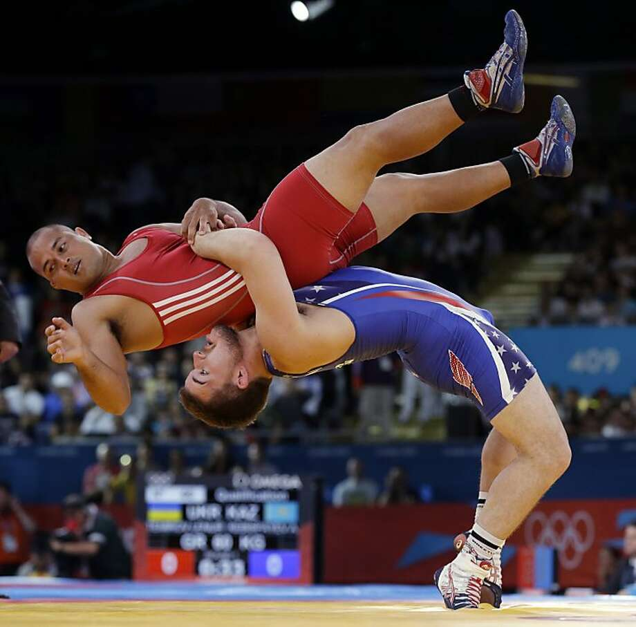 Charles Edward Betts of the United States (right) and Keitani Graham of Micronesia compete in Greco-Roman wrestling in London. The sport will be contested in Rio, but leaves the Games in 2020. Photo: Paul Sancya, Associated Press