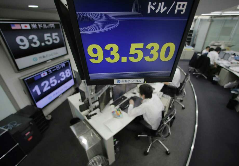 Against the dollar, the yen is near a three-year low and looks set to weaken further as the Bank of Japan falls in line to push the economy out of its deflationary slump by creating more money. Photo: Itsuo Inouye / Associated Press
