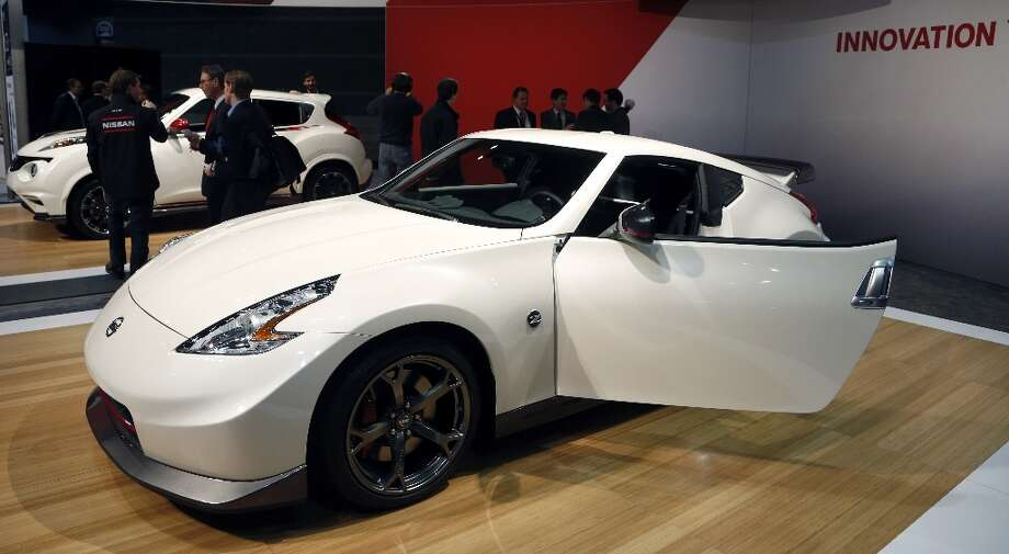 The 2014 Nissan 370Z Nismo is revealed at the Chicago Auto Show Thursday, Feb. 7, 2013, in Chicago. (AP Photo/Charles Rex Arbogast) Photo: Charles Rex Arbogast, Associated Press / AP