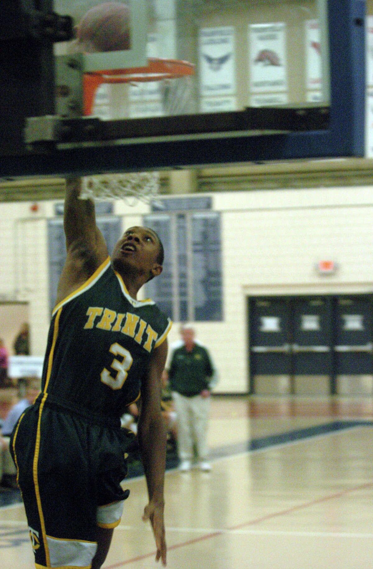 Trinity's Tremaine Frasier shoots as Wilton High School hosts Trinity Catholic in a boys basketball game in Wilton, Conn., Feb. 12, 2013.