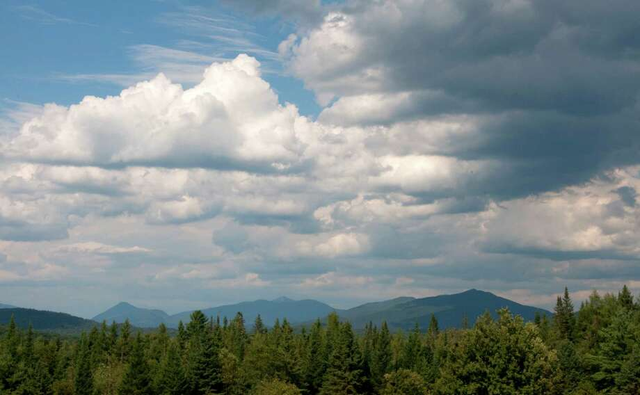 View of some of the Adirondack mountains on Wednesday Aug. 7, 2012, from Newcomb, N.Y.  (Philip Kamrass / Times Union archive) Photo: Philip Kamrass / 00018772A