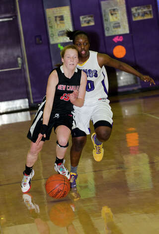 New Canaan's Liz Miller (13) controls the ball as Westhill's Tyler Evans (20) defends during the girls basketball game at Westhill High School in Stamford on Tuesday, Feb. 12, 2013. Photo: Amy Mortensen / Connecticut Post Freelance