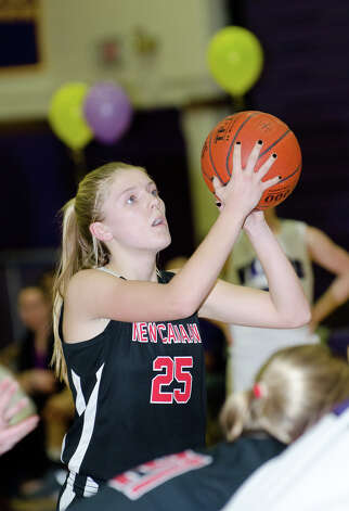 New Canaan's Kelly Armstrong (25) takes a foul shot during the girls basketball game against Westhill at Westhill High School in Stamford on Tuesday, Feb. 12, 2013. Photo: Amy Mortensen / Connecticut Post Freelance