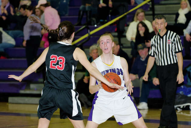 Westhill's Steph Roones (5) controls the ball as New Canaan's Georgia Hunsinger (23) defends during the girls basketball game at Westhill High School in Stamford on Tuesday, Feb. 12, 2013. Photo: Amy Mortensen / Connecticut Post Freelance