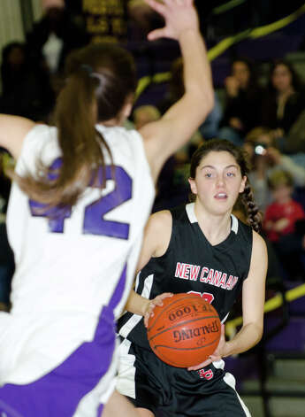New Canaan's Georgia Hunsinger (23) looks to pass during the girls basketball game against Westhill at Westhill High School in Stamford on Tuesday, Feb. 12, 2013. Photo: Amy Mortensen / Connecticut Post Freelance