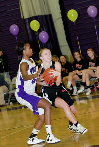 New Canaan's Kelly Armstrong (25) controls the ball as Westhill's Krystal Dixon (30) during the girls basketball game at Westhill High School in Stamford on Tuesday, Feb. 12, 2013. Photo: Amy Mortensen / Connecticut Post Freelance